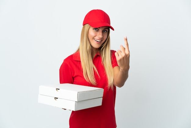 Pizza delivery woman holding a pizza isolated on white space doing coming gesture