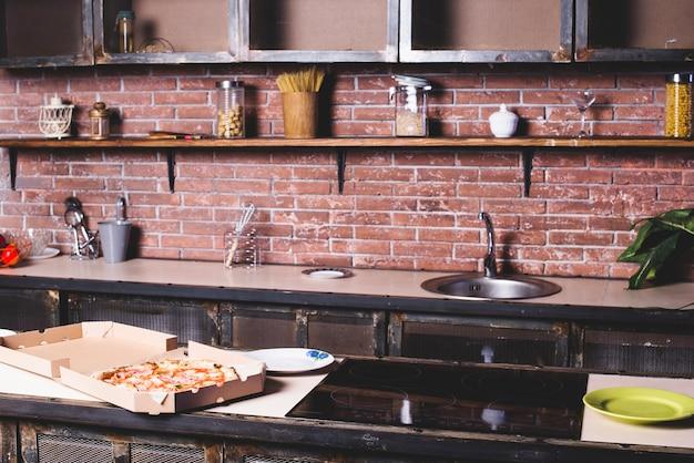 Pizza on empty kitchen