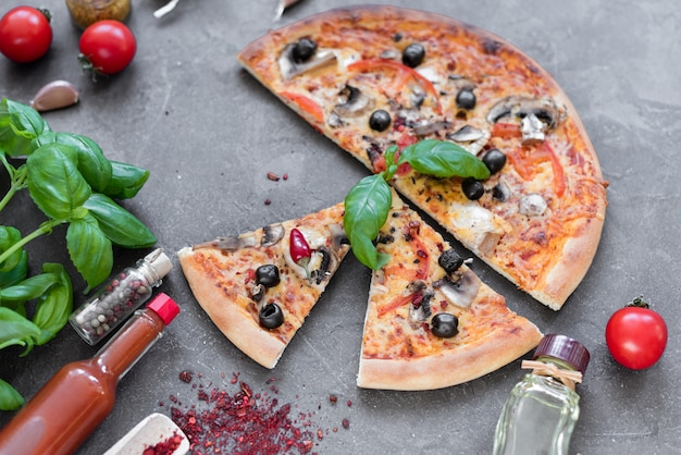 Pizza, food, vegetable.  vegetables, mushrooms and tomatoes pizza on a dark background. it can be used as a background