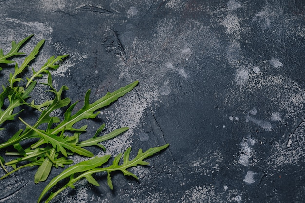 Pizza ingredients on dark concrete background, neapolitan pizza, cooking concept