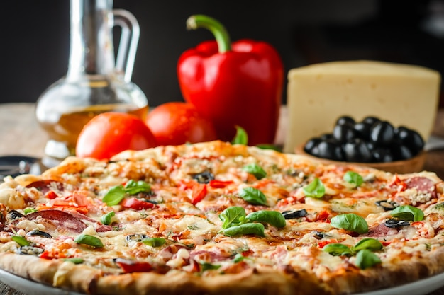 Pizza and ingredients on table