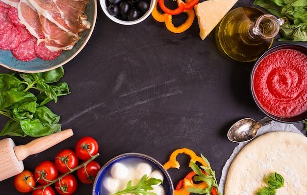 Фон приготовления пиццы. ингредиенты для приготовления пиццы.