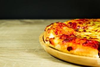 Pizza Margarita with mozzarella cheese .