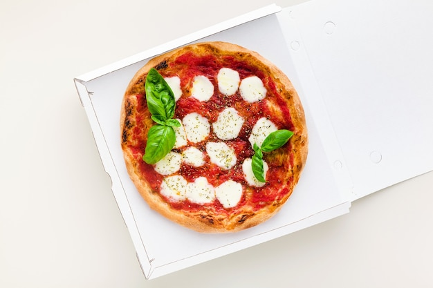Pizza margherita in a box for delivery