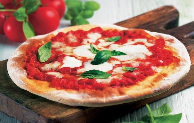 Pizza margherita with tomato, mozzarella cheese and basil.
