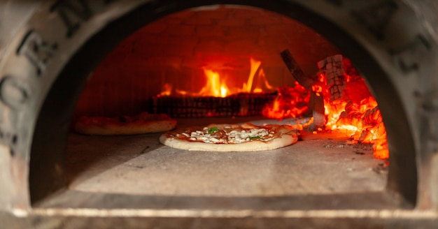 Pizza margherita in a wood oven.