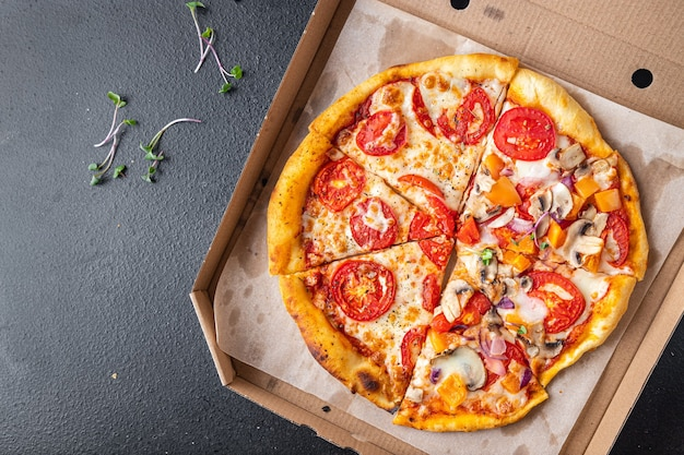 Pizza mix different types of pizza in one box fresh portion ready to eat meal snack on the table