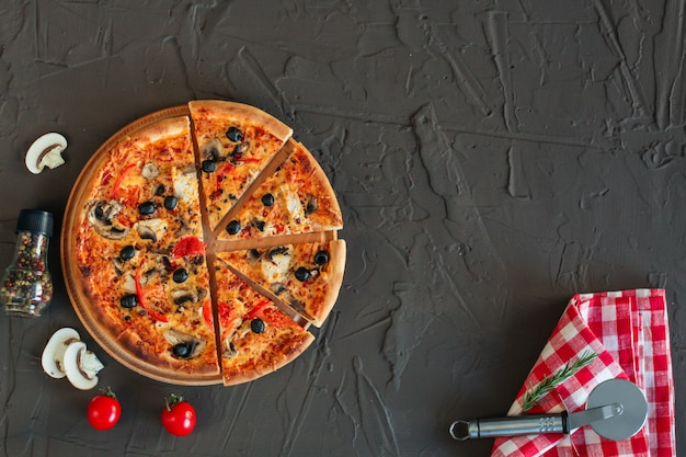 Pizza, mushrooms, olives, tomato sauce, cheese. food background
