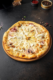 Pizza seafood mussels shrimps rapana octopus scallop cheese fast food fresh meal snack