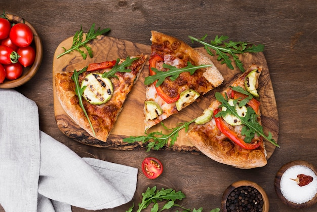 Pizza slices on wooden board above view
