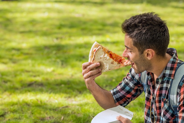 Pizza time.student having lunch break.