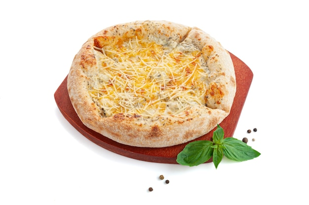 Pizza with cheese on a wooden tray. decorated with basil and spices. white background. isolated.