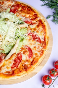 Pizza with extra cheese and greenery