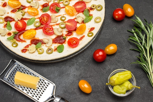 Pizza with ingredients is ready to bake