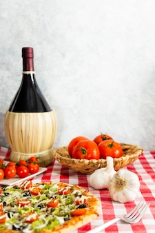 Pizza with large wine bottle