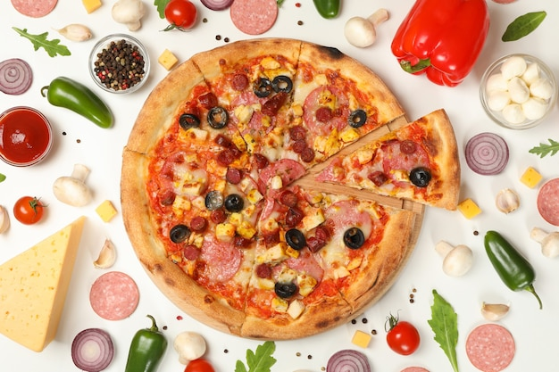 Pizza with meat and ingredients on white