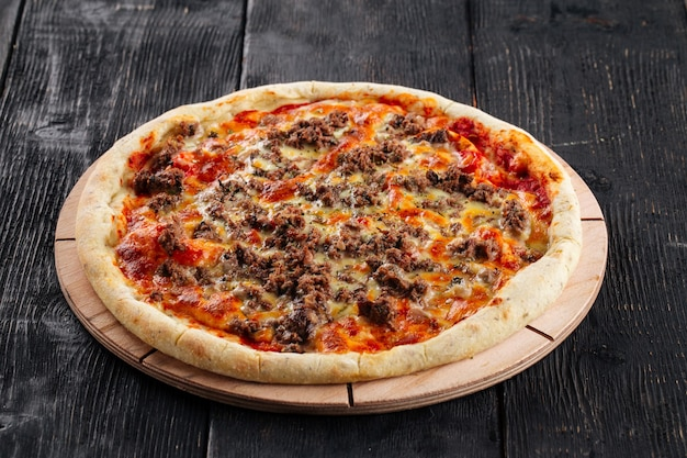 Pizza with minced meat and tomato sauce