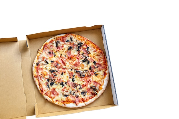 Pizza with mushrooms, cheese and ham in a carton box isolated