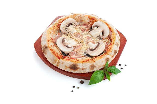 Pizza with mushrooms and ham. on a wooden tray. decorated with basil and spices. white background. isolated.