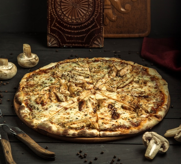 Pizza with mushrooms and sesame