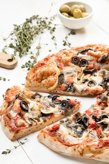 Pizza with olives and vegetables