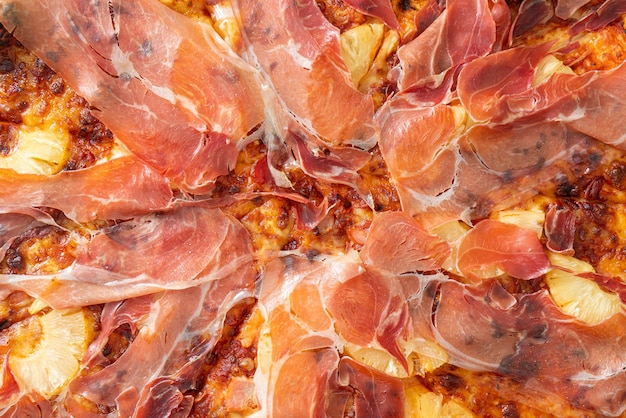 Pizza with prosciutto or parma ham pizza - italian food style