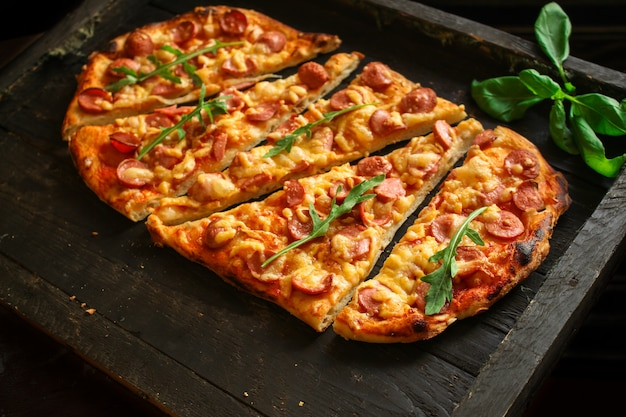 Pizza with sausages (tomato sauce, cheese, meat)