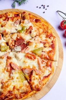 Pizza with sausages and vegetables