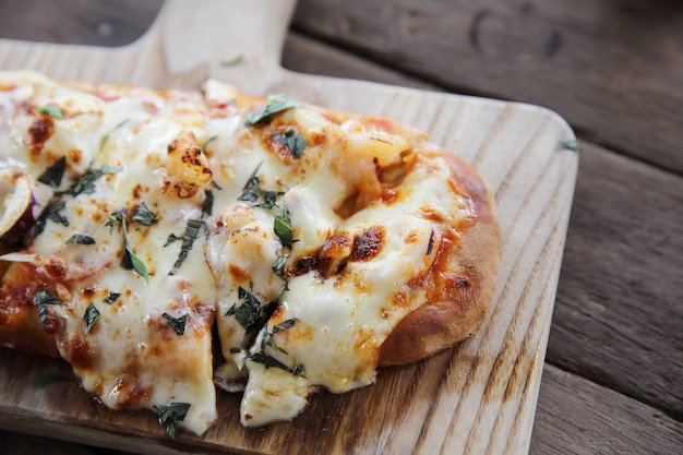 Pizza with seafood on wood background italian food