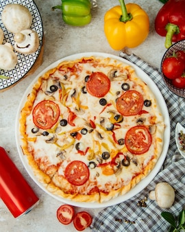 Pizza with tomato olives and bell peppers