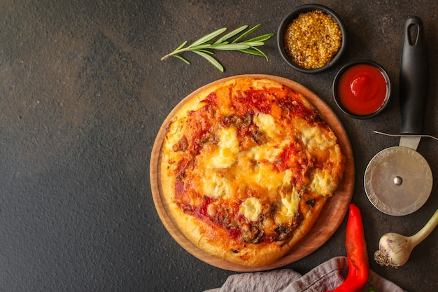 Pizza with tomato sauce and cheese