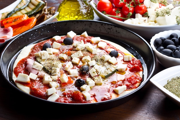 Pizza with tomatoes,mozzarella,black olives and grilled vegetabl