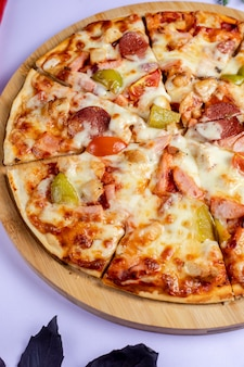 Pizza with vegetables and sausages