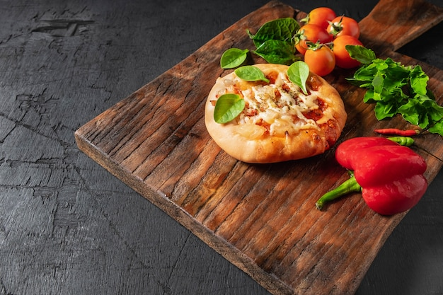 Pizza  on wooden pizza board