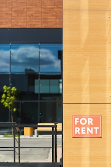 Placard for rent on the wall of modern house