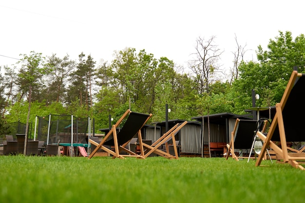 The place for longe deck chairs kind on the playground jumping on the trampoline in the back yard