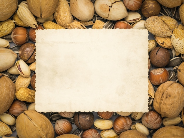 Place the text on the background of a mixture of a large number of nuts. vegetarian food.