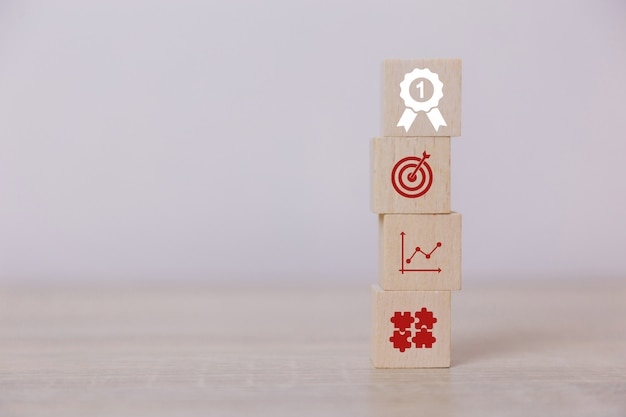 Place vertical wooden blocks service concept of business to success business strategy planning to market victory.