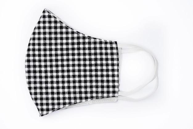 孤立した背景に格子縞のパターンの黒と白の背景