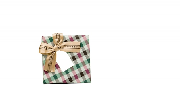Plaid pattern gift box with beige ribbon bow and blank greeting card isolated on white background with copy space, just add your own text. use for christmas and new year festival