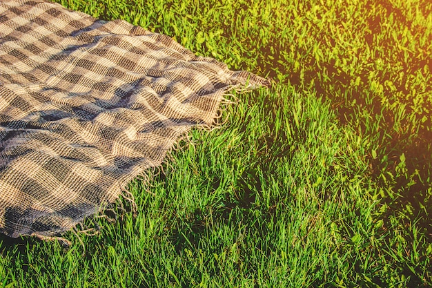 Plaid for a picnic on the grass. selective focus.