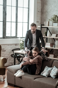 Plaid on shoulders. caring loving father putting plaid on shoulders of his daughter feeling sick