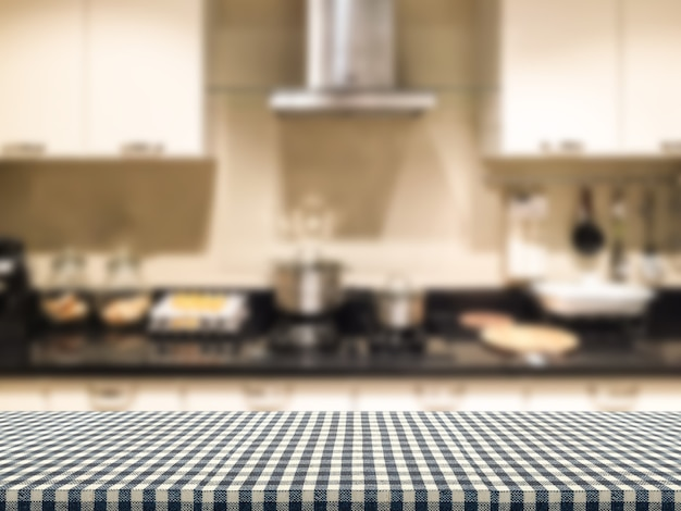 Plaid tablecloth with kitchen interior background