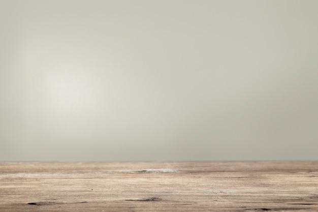 木製の床の製品の背景を持つプレーンベージュの壁
