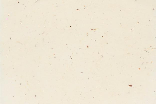 Spazio vuoto della carta da parati beige normale