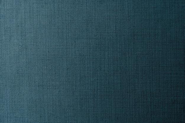無地の紺色の生地の織り目加工の背景