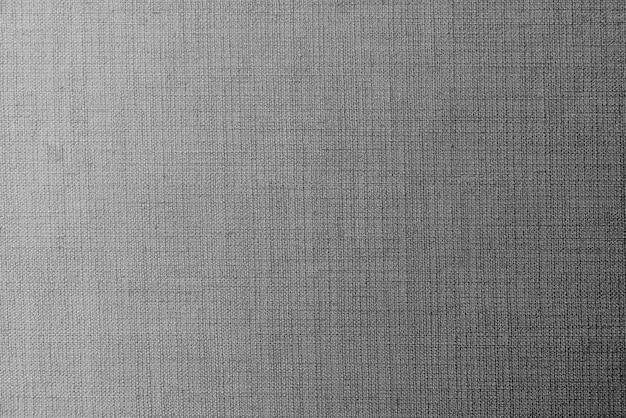 無地の灰色の生地の織り目加工の背景
