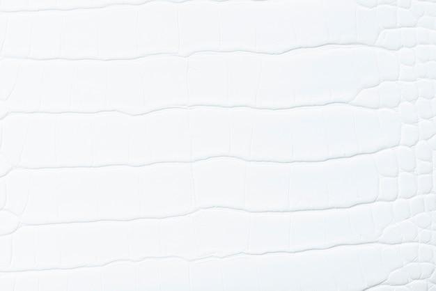 無地の白い革の織り目加工の背景