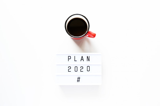 Plan 2020 with cup of coffee