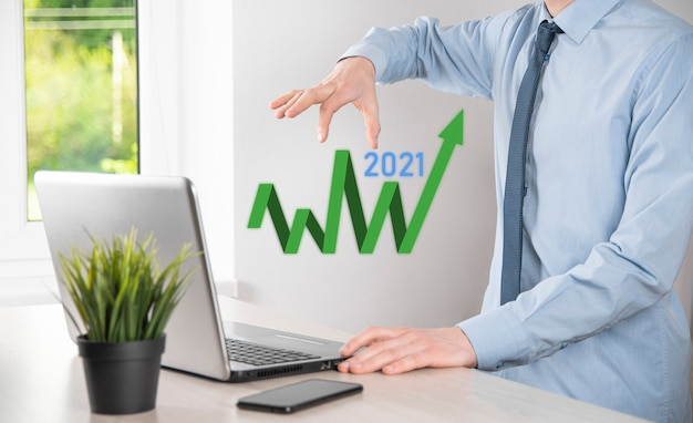 Plan business growth in year 2021 concept. businessman plan and increase of positive indicators in his business, growing up business concepts.